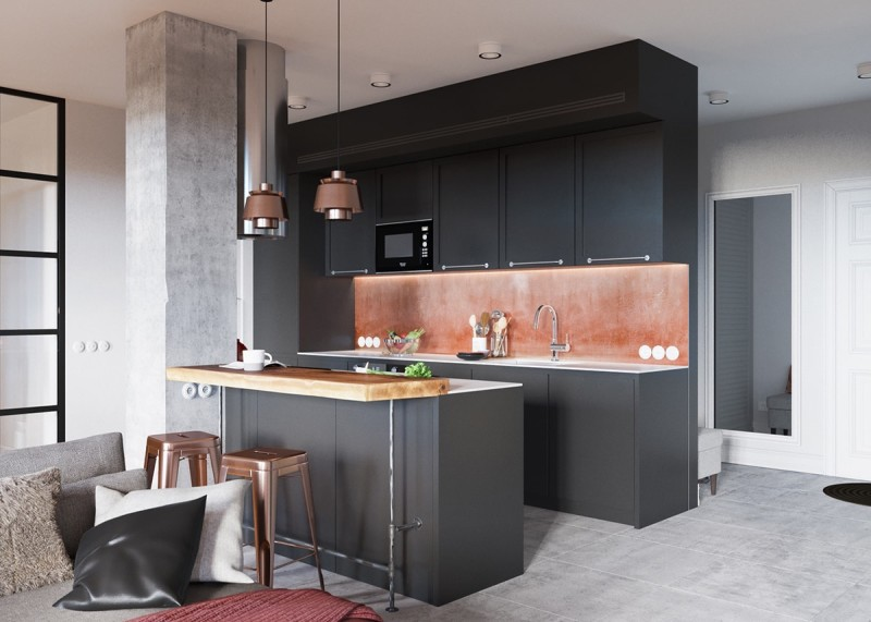 Claves_para_crear_contrastes_de_color_en_la_decoración_espacio_salón_black-kitchen-with-copper-backsplash-min